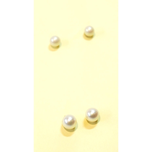 31 - Two pairs of cultured pearl ear studs....