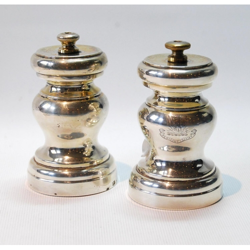 33 - Pair of silver baluster pepper mills, crested, by Mappin & Webb, Birmingham 1914, gross 9½oz....