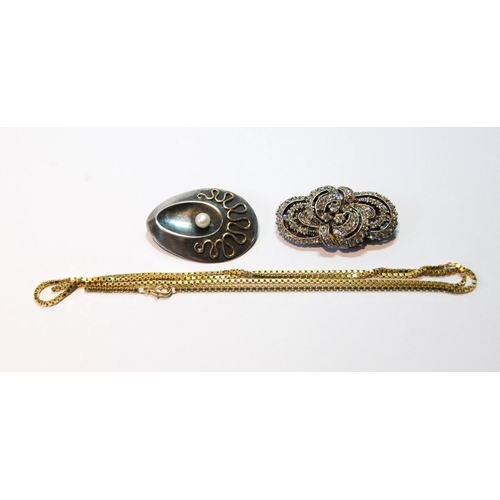 39 - Silver brooch of ovoid abstract form with pearl and gold squiggle, a continental paste clip and a gi...