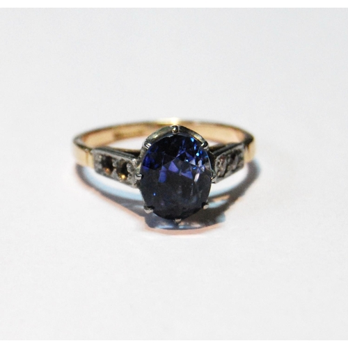 43 - Sapphire ring with Ceylon hued stone approximately 9mm x 7mm x 7mm deep with diamond-set shoulders (...
