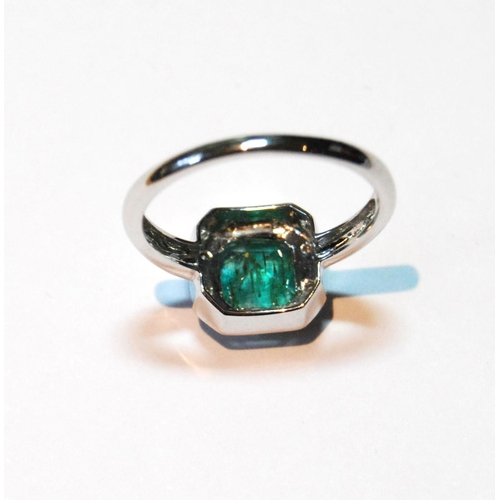47 - Emerald and diamond ring, rectangular with cut corners, '2.6ct', and border of tiny brilliants in wh...