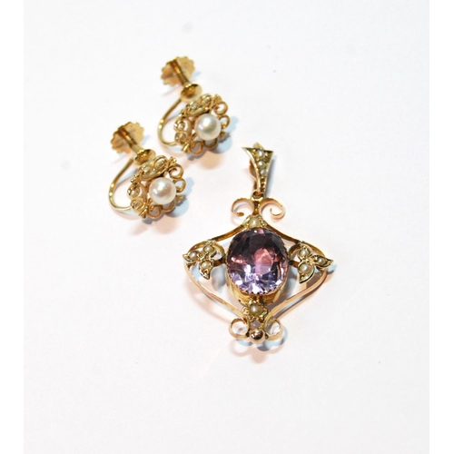 51 - Edwardian gold openwork pendant with amethysts and pearls, and a pair of pearl earrings....
