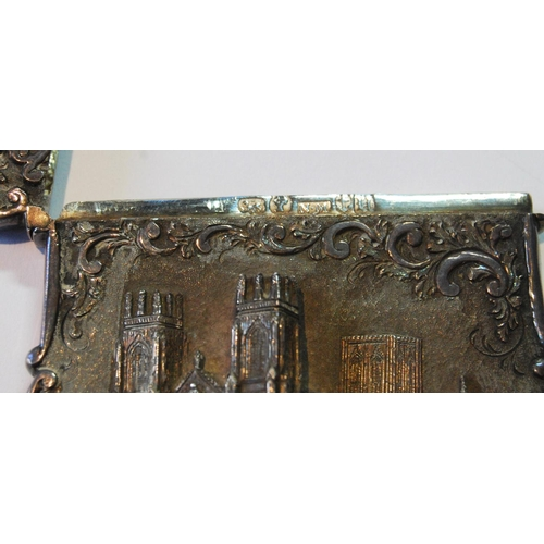 50 - Silver 'castle top' card case with a view of York Minster in high relief amongst scrolls by Nathanie...