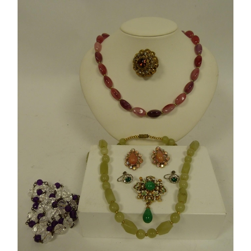 24 - Box of vintage costume jewellery to include brooches, earrings, necklaces etc....