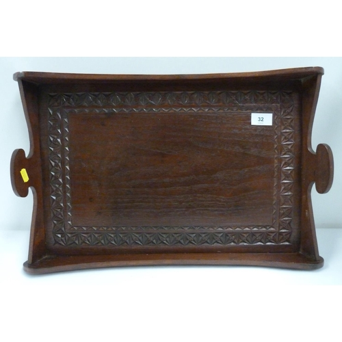 32 - Carved oak twin handled tray...