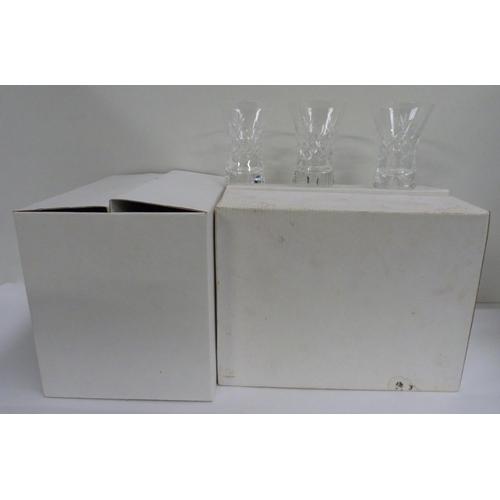 54 - Twelve small Cumbria crystal fluted Keswick cut vases....