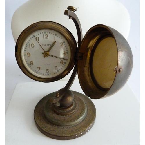 59 - Vintage brass globe travel alarm clock....