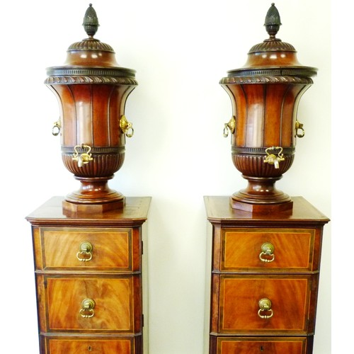 330 - Pair of George III mahogany wine cisterns, on cupboard stands, the cisterns formed as urns with dome...