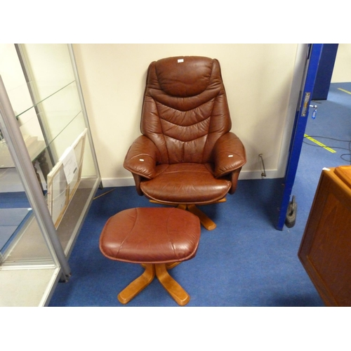 1 - Modern brown leather arm chair and footstool.