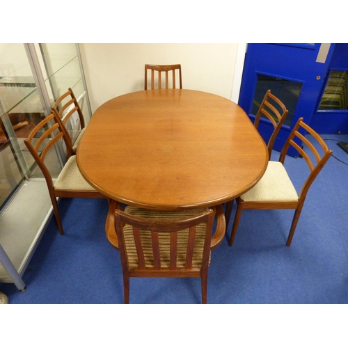 23 - G Plan dining table and six chairs to include carvers.