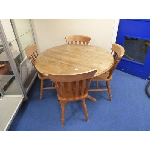 25 - Round pine country style dining table and four chairs (St. Michaels Furniture).
