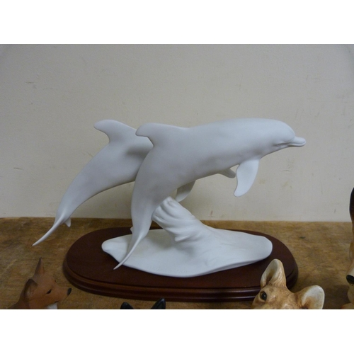 32 - Five corgi dog figures and Kaiser dolphin figure group.