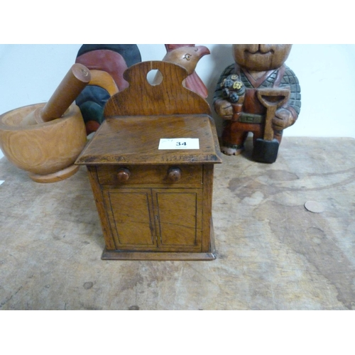 34 - Collection of treen items to include carved chicken, carved bear, pestle and mortar etc.