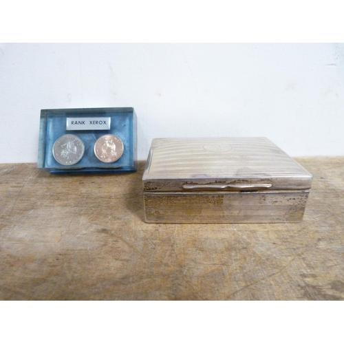 36 - Silver cigarette box and a paperweight inset two coins.