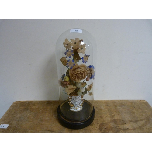 44 - Antique glass dome with containing floral decoration.