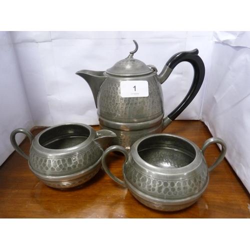 1 - Cameo pewter hand-beaten tea set, and associated tea glasses....