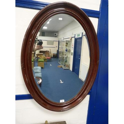 18 - Oval framed mirror....