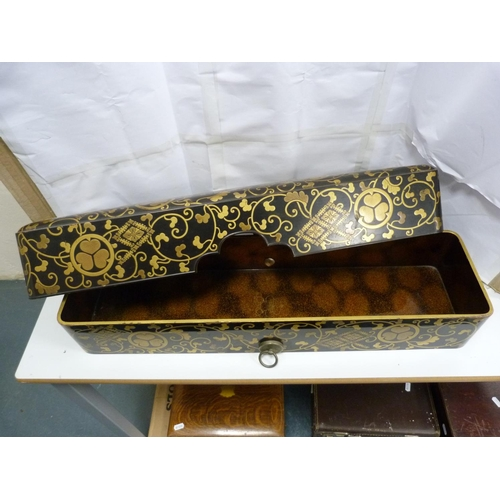 21 - Large Japanese lacquered scroll box, and a parasol....