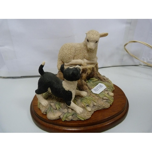 23 - Lilliput Lane model, Border Fine Arts model, and another, also a curling stone inkwell. (4)...