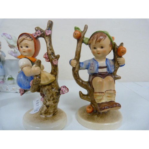 32 - Two Hummel figures, and others.  (7)...