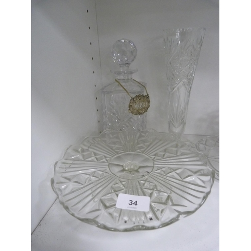 34 - Assorted crystal and glassware including vases, and decanter....