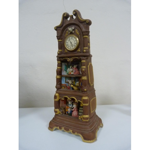 36 - Three mantel clocks including Mouse Manor musical grandmother clock, Franklin Mint, and another....