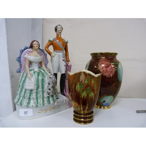 37 - Carlton Ware Rouge Royale vases, and a Staffordshire figure group of Victoria and Prince Albert.&nbs...