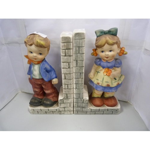 5 - Fairylite pair of bookends, and two other figures. (4)...
