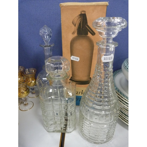 7 - Three decanters, two vases, a set of gilt decorated aperitif glasses, and a soda syphon....