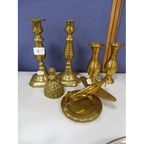 8 - Brass model of a Spitfire, pair of associated candlesticks, brass bell, and a pair of posy vases....