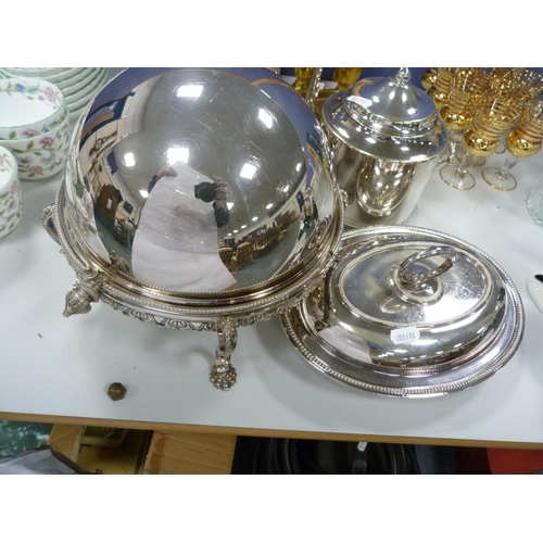 9 - Assorted plated ware including biscuit barrel, plate warmer, gravy boat, condiments, and napkin ring...