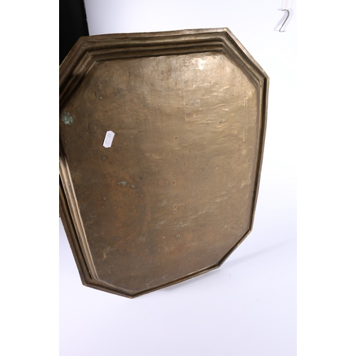 23 - Indian brass tray of octagonal shape with incised decoration of delies and a lion on a ground of scr...