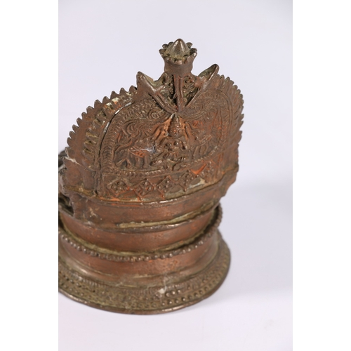 24 - 19th century Indian bronze oil lamp with peacock decoration to the handle, another Indian bronze vot...