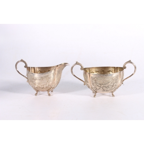 20 - 19th Century Indian white metal part teaset of sugar and milk jug of lobed spherical form with scrol...