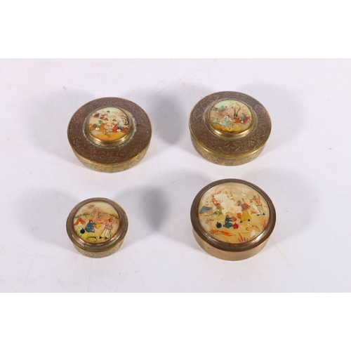 6 - Four Iranian copper and brass circular boxes with painted mother of pearl shell tops, the largest 6c...