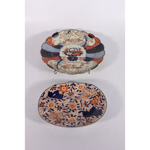 7 - 19th century Oriental Imari dish 31cm diameter and an oval Imari dish 25cm long, (2)