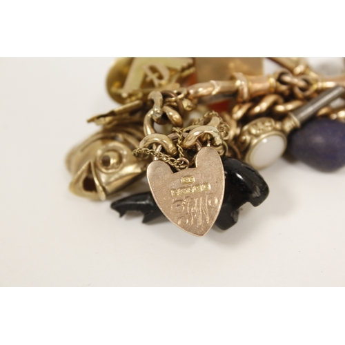 11 - Gold hollow curb bracelet with various gem set and other charms, mostly 9ct gold....