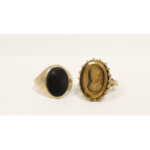 13 - 9ct gold signet ring with intaglio 'tigers eye' portrait and another with onyx. (2)....