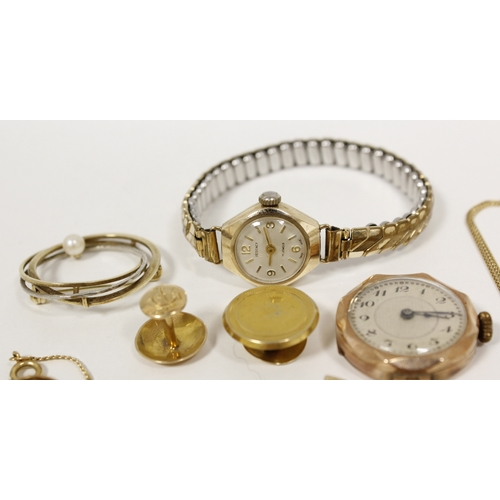 19 - 9ct gold circle brooch, another three pendants and a lady's 9ct watch, 1928 and various other items,...