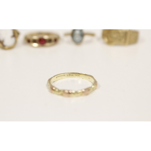 25 - Four gem rings in 9ct gold and another '14'....