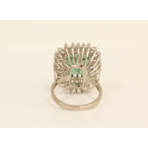 28 - Impressive diamond and emerald cluster ring, the emerald given as approx. 3.5ct surrounded by baguet...