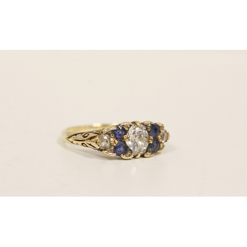 37 - Edwardian ring with diamond brilliant, approx. .6ct, flanked by four sapphires and two smaller brill...