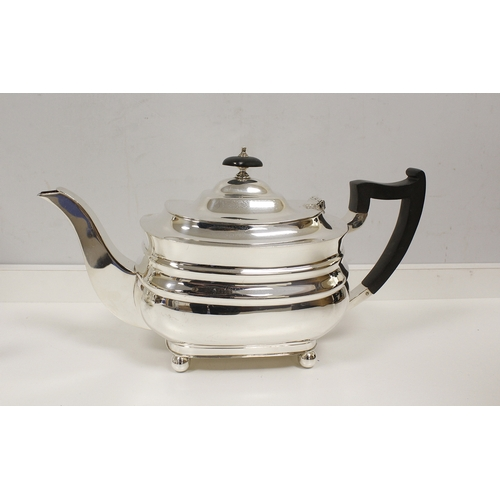 39 - Silver four-piece tea set of boat shape on ball feet, by Wilson & Sharp Sheffield, 1963. 56oz.&n...