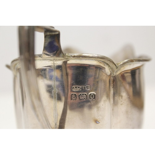 4 - Silver three-piece tea set, oval with fluted corners, Birmingham 1913. 18oz....