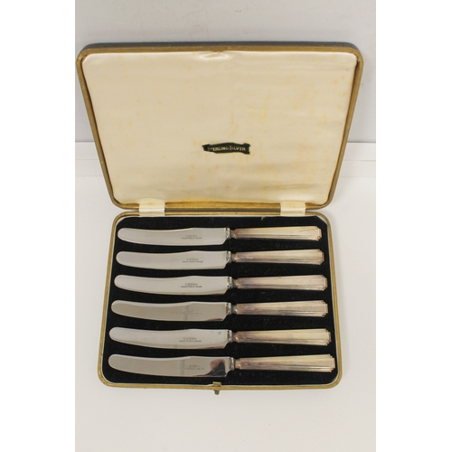 47 - Set of six enamelled coffee spoons (a.f.), six silver handled tea knives, (both cased) and various ...
