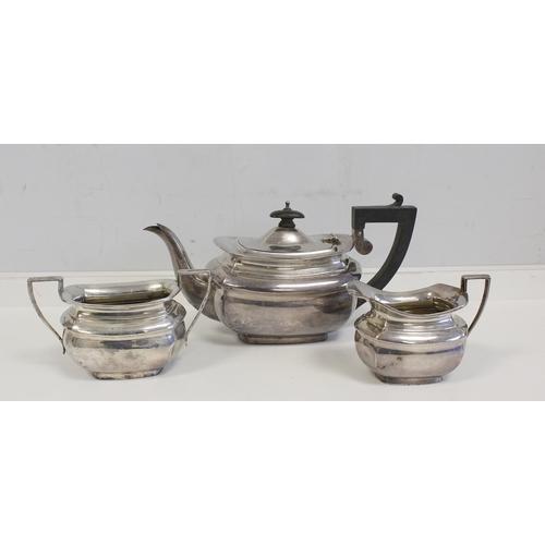 2 - Silver three-piece tea set of panelled boat shape, Birmingham & Chester, 1915. 16oz....