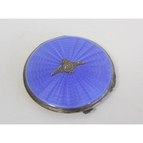 20 - Silver circular compact with blue enamel and RAF badge 1937, another similar, a cigarette case and a...
