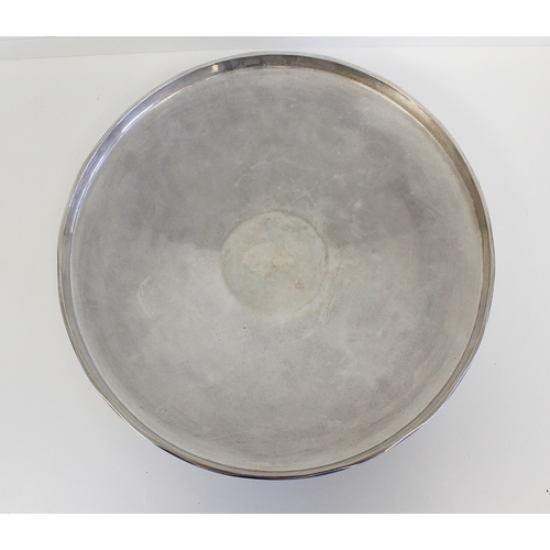 27 - Silver shallow bowl or tazza of Art Deco style with vertical border and gilt and waved bands upon sp...
