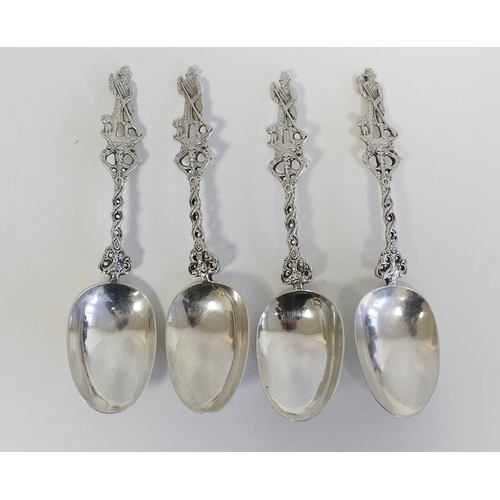 29 - Set of four Dutch 19th century silver spoons with 'fantasy' marks and cast openwork stems. 9 1/2oz....