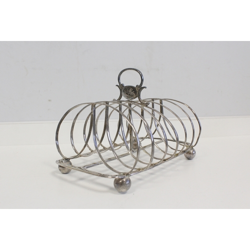 3 - Silver toast rack with arched wires, for six, by W Fountain, 1828. 6oz....